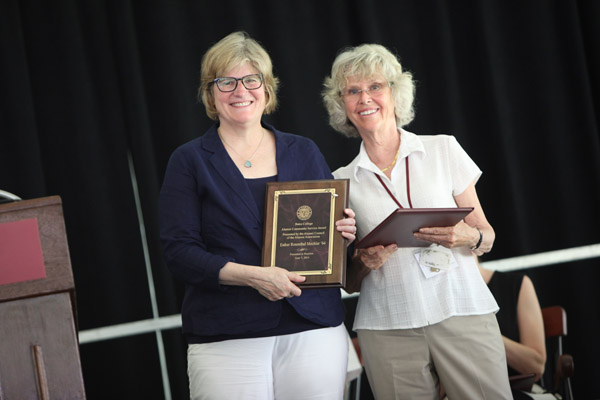 Esther Rosenthal Mechler '64, right, receives the Alumni Community Service Award from President Clayton Spencer at the Annual Gathering of the Alumni Association on June 7, 2014. (H. Lincoln Benedict)