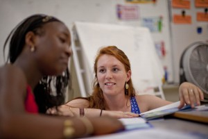 Brenna Callahan works with an unidentified pupil at Montello School. (Phyllis Graber Jensen/Bates College)