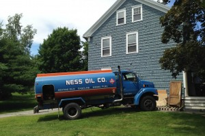 A local oil dealer sent a truck to recover heating fuel from the former Intercultural Education office on July 9. (Doug Hubley/Bates College)