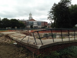 Site of the former 75 Campus Ave., once the home of Bates' religion and philosophy faculties, shown on Aug. 12, 2014. Lewiston Middle School is in the background. (Doug Hubley/Bates College)