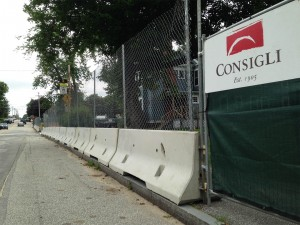 Replacing a provisional fence around the Campus Life Project site the week of Aug. 11, this fence will remain for the duration of the construction. (Doug Hubley/Bates College)