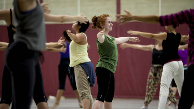 Regan Radulski '15 (green top) takes part in a modern-dance class during the Bates Dance Festival. (Sarah Crosby/Bates College)