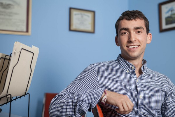 Evan Cooper '15 poses for a portrait at Pine Tree Legal, where he is working to provide legal aide to those who can't afford it, during a summer internship sponsored by the Harward Center. (Sarah Crosby/Bates College)