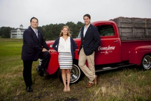 At Ocean Spray headquarters in Middleborough, Mass., Peter Wyman '86 (left) joins Pat Quinn '12 and Ladd Intern Kelsey Mehegan '15 of Duxbury, Mass., for a photograph. Wyman is vice president for global business development at Ocean Spray, while Quinn is associate trade marketing manager. (Sarah Crosby/Bates College)