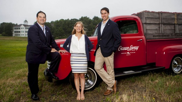 At Ocean Spray headquarters in Middleborough, Mass., Peter Wyman '86 (left) joins Pat Quinn '12 and Ladd Intern Kelsey Mehegan '15 of Duxbury, Mass., for a photograph. Wyman is vice president for global business development at Ocean Spray, while Wyman is associate trade marketing manager. (Sarah Crosby/Bates College)