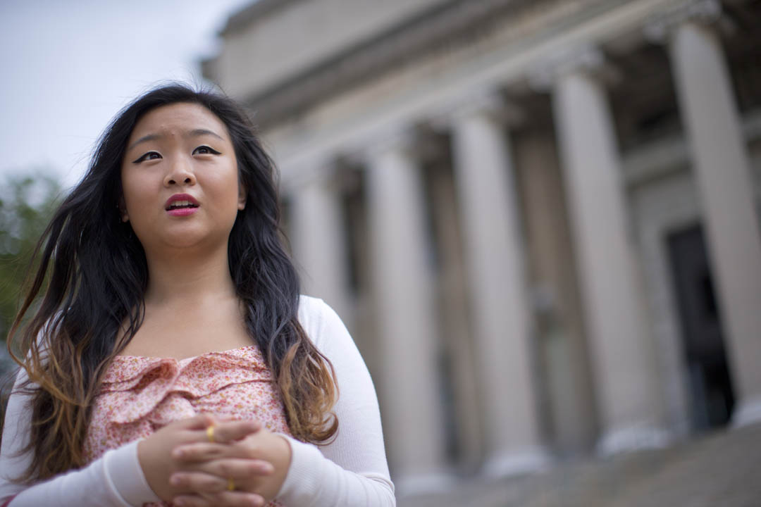 Eileen Lam '15, a politics and Chinese double major from New York City, stands on the steps of Columbia University's Low Memorial Library. She received a summer research fellowship through Creating Connections Consortium, of which Bates is a member. The program creates pathways for students from underrepresented groups to explore becoming college professors. (Phyllis Graber Jensen)