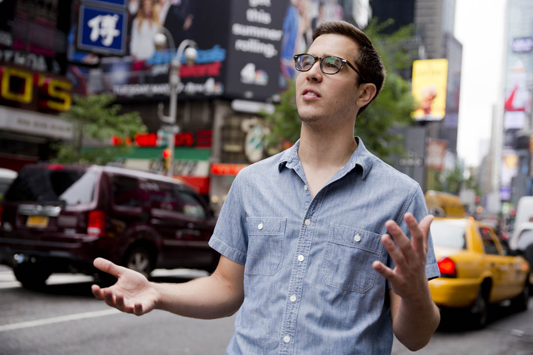 Henry Baird '17 of New York City experiences Times Square outside of the historic Brill Building at 1619 Broadway, where he is a production intern for Above Average Productions, a digital comedy network featuring short-form series and videos. (Phyllis Graber Jensen/Bates College)