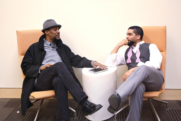 Theater director Ozzie Jones '92 (left) talks with David Wall Rice, professor of psychology at Morehouse College, following a 2012 Bates conference of black and latino men from Colby, Bates and Bowdoin colleges. (Simone Schriger '14/Bates College)