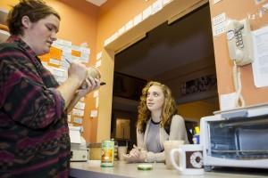 Colette Girardin '16, at right, orders a chai latte at le Ronj on Sept. 18, the first day of breakfast hours for the coffeehouse. Stocking Manager Max Pendergast '15 serves coffee and breakfast from 7-10 a.m.