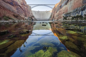 "Cold water trickles out of the Glen Canyon Dam into what's left of Glen Canyon, forming an unnatural stretch of trout water on the Arizona/Utah border, in a scene from ""DamNation."" (Ben Knight)"