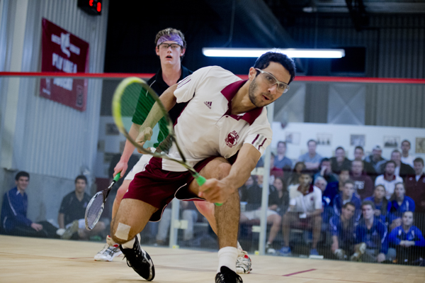 Two-time NESCAC Player of the Year Ahmed Abdel Khalek '16 takes on a player from Amherst College on January 15, 2013. (Phyllis Graber Jensen/Bates College)