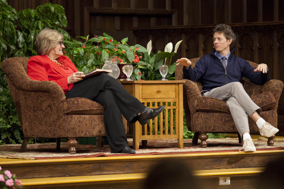 "President Clayton Spencer interviews Thomas Goetz '90 about his book ""The Remedy"" in the Gomes Chapel. The book was the Common Read for the Class of 2018. (Sarah Crosby/Bates College)"