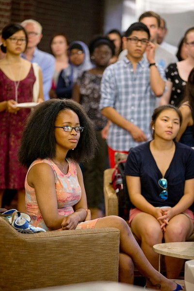 Nolwazi Ngwenyama '16 of Mbabane, Swaziland, listens to a speaker at the reception for the opening of the Office of Intercultural Education's new home in Chase Hall. She's an OIE Fellow for 2014-15. (Phyllis Graber Jensen/Bates College)