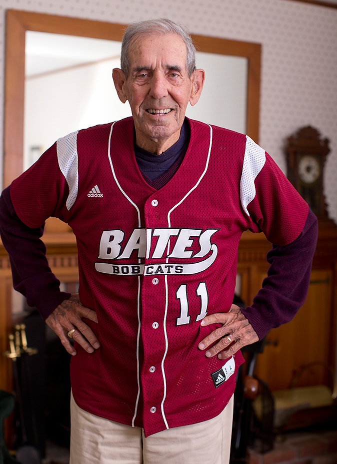 """William """"Chick"""" Leahey '52 dons his No. 11 Bates jersey at his home on East Avenue. His jersey will be retired Saturday at halftime of the Homecoming football game vs. Colby. (Phyllis Graber Jensen/Bates College)"""