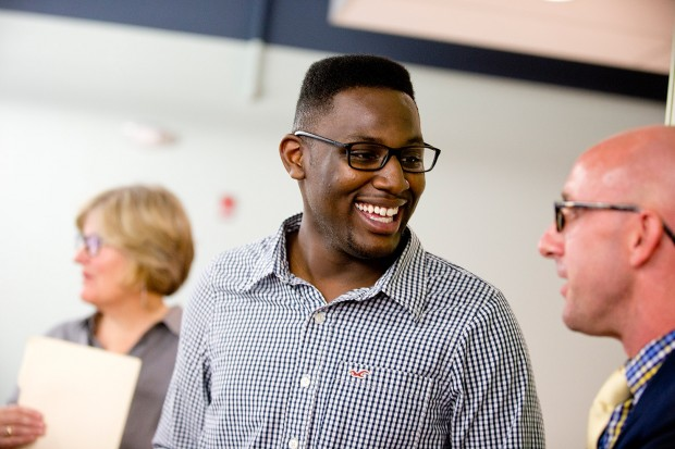 Jalen Baker '16 of Lancaster, Texas, talks with Dean of Students Josh McIntosh during the reception celebrating the new home of the Office of Intercultural Education. (Phyllis Graber Jensen/Bates College)