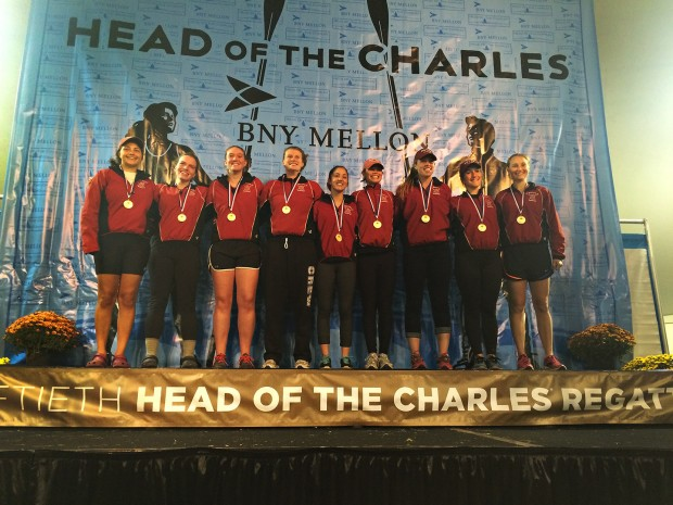 The women's varsity eight basks in the glow of victory following its win in the Women's Collegiate Eights at the Head of the Charles Regatta on Oct. 19, 2014. (Photograph by Andriel Doolittle)