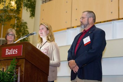 Jeff Sturgis '69, recipient of the David G. Russell Award for outstanding admission volunteer work, stands by as Dean of Admission Leigh Weisenburger reads the citation and President Spencer listens. (Rene Minnis for Bates College)