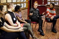 From right, Aino Jawo and Caroline Hjelt -- the Swedish DJ duo Icona Pop -- speak with Bates student leaders prior to their Campus Consciousness Tour concert on Nov. 1. Shown from left are Shana Wallace 'XX, Taylor B;lackburn 'XX and XXX. (Sarah Crosby/Bates College)