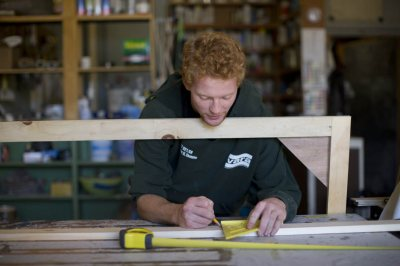 Dylan Malone '17 of Needham, Mass., helps to build a theater set in the Schaeffer Theatre carpentry shop. He's in Michael Reidy's course on theater technology. (Phyllis Graber Jensen/Bates College)
