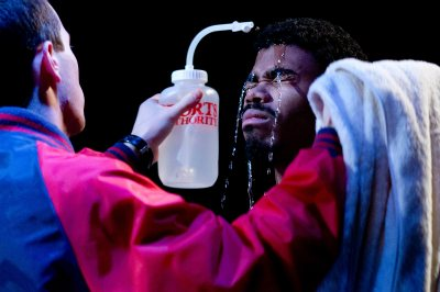 "Freddie gets help from Jo-Jo in a scene from ""Boxing 2000."" (Phyllis Graber Jensen/Bates College)"