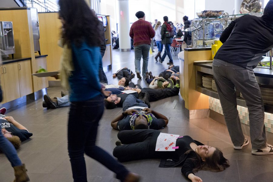 """At lunchtime in Commons on Dec. 2, 50-plus students mounted a Ferguson-inspired protest art demonstration """"to interrupt the flow of normal life so that we are prompted to truly question the society we live in,"""" said organizer Annakay Wright '17 of Brooklyn, N.Y. (Phyllis Graber Jensen/Bates College)"""