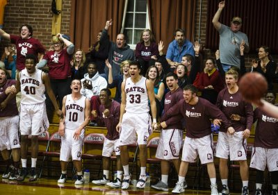 Players and fans in Alumni Gym erupt after a dunk by Graham Safford '15 of Stratton, Maine. Bates beat Bowdoin 71-51 on Dec. 4. (Sarah Crosby/Bates College)