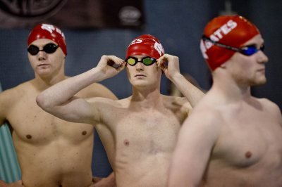 Swimmers Jonathan Depew '18 of Hudson, Ohio, Ned Thunem '17 of New Canaan, Conn., and Alex Smachlo '15 of Rexford, N.Y., prepare for their Dec. 6 meet at Tarbell Pool. Bates outscored UMaine for the first time since 2009. (Phyllis Graber Jensen/Bates College)