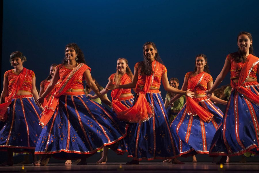 The Bollywood Team energizes the Schaeffer Theatre stage during Sangai Asia Night 2014. (Sarah Crosby/Bates College)