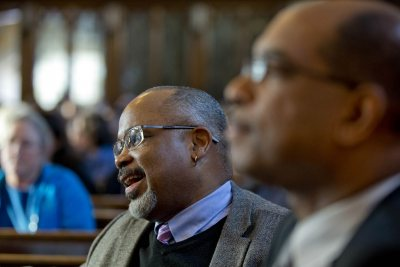 Marcus Bruce, Benjamin E. Mays Distinguished Professor of Religious Studies, and Associate Dean of Students James Reese listen to the MLK Day keynote address. (Phyllis Graber Jensen/Bates College)
