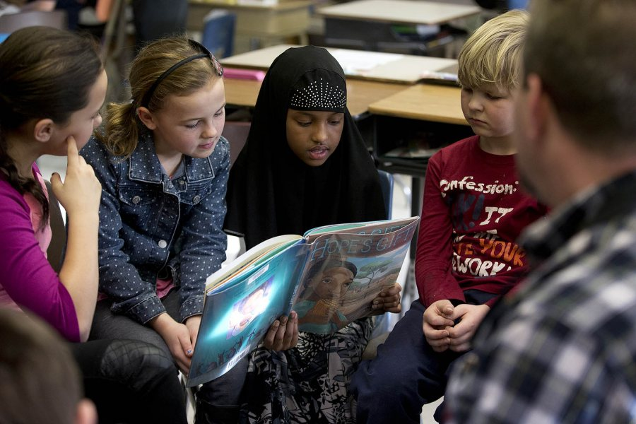 Bates men's lacrosse coach Peter Lasagna (with back to camera) works with fourth-graders at Martel School on Jan. 21, 2015, during the annual Rev. Dr. Martin Luther King Jr. Read-In. (Phyllis Graber Jensen/Bates College)