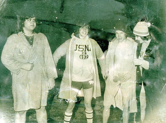 "From left, Mark Stevens '77, Scott Copeland '78, Chris Callahan '78, Lars Llorente '78 — the founders of the Puddle Jump — prepare for the inaugural dip in 1975. Over the years, students slowly ""migrated"" the event away from March, when it was known as the the St. Patrick's Day Dip, to Winter Carnival week."