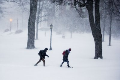 As a blizzard rages, students cross the Historic Quad during the morning hours of Jan. 27, 2015. (Phyllis Graber Jensen/Bates College)