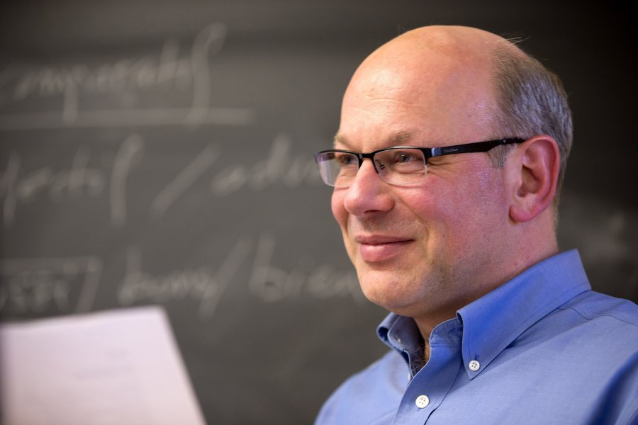 Alexandre Dauge-Roth, associate professor of French and francophone studies, shown during a class. (Phyllis Graber Jensen/Bates College)