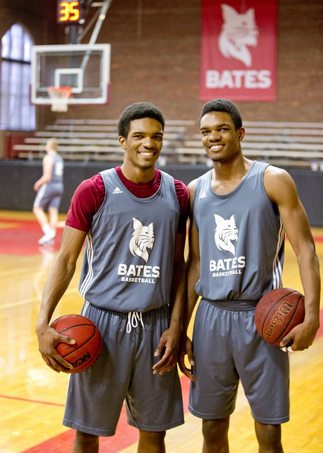 Marcus Delpeche '17 (left) and Malcolm Delpeche '17, identical twin brothers from Wilmington, Del., pose for a photograph during practice in Alumni Gymnasium. (Phyllis Graber Jensen/Bates College)