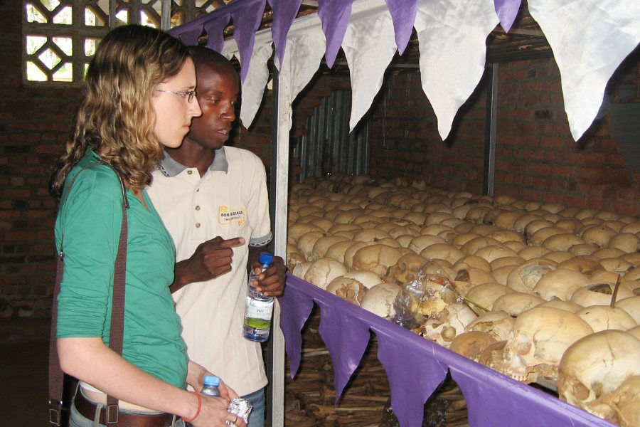 "Together, Sarah Bravmann '12 and Alexis Mutimukunda face a genocide exhibit of human skulls at the Ntarama Memorial in Rwanda during the ""Learning with Orphans of the Genocide in Rwanda"" Short Term in 2009 led by Alex Dauge-Roth, associate professor of French and francophone studies."
