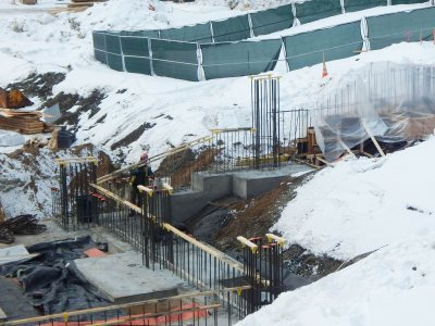 Foundation work extends down into the basement pit at 65 Campus Ave. on March 2, 2015. The vertical rebar forms will be piers to support columns. (Doug Hubley/Bates College)