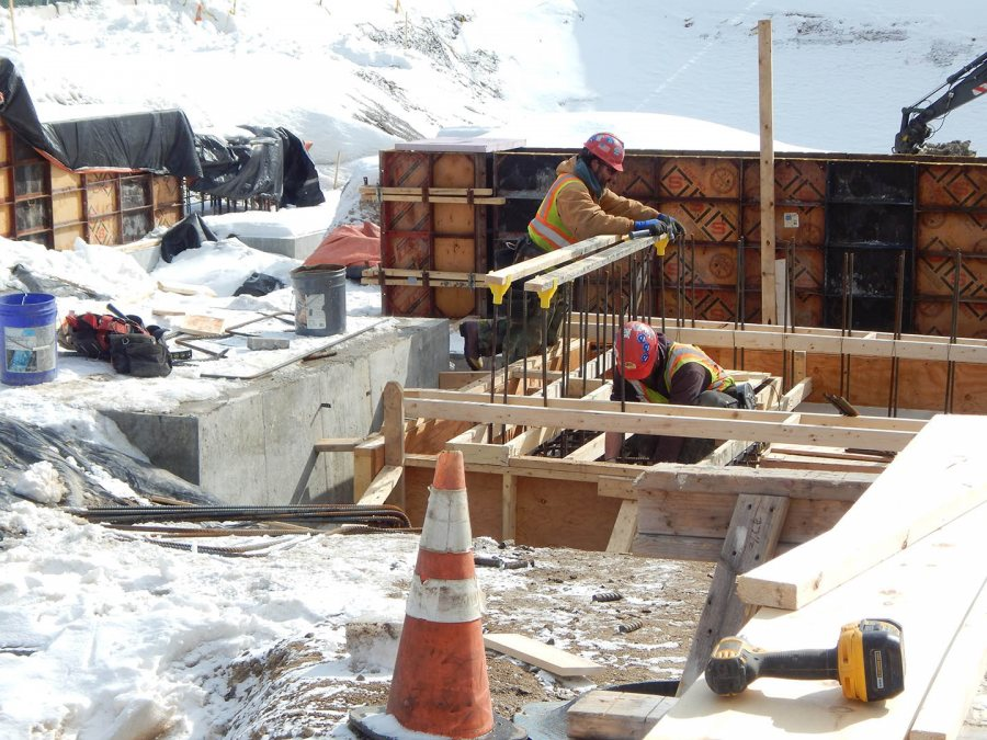 At work on a foundation at 65 Campus Ave. (Doug Hubley/Bates College)