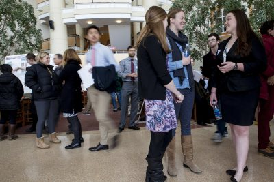 Students chat and crowds move through the Perry Atrium at Bates College during the 2014 Mount David Summit. (Sarah Crosby/Bates College)
