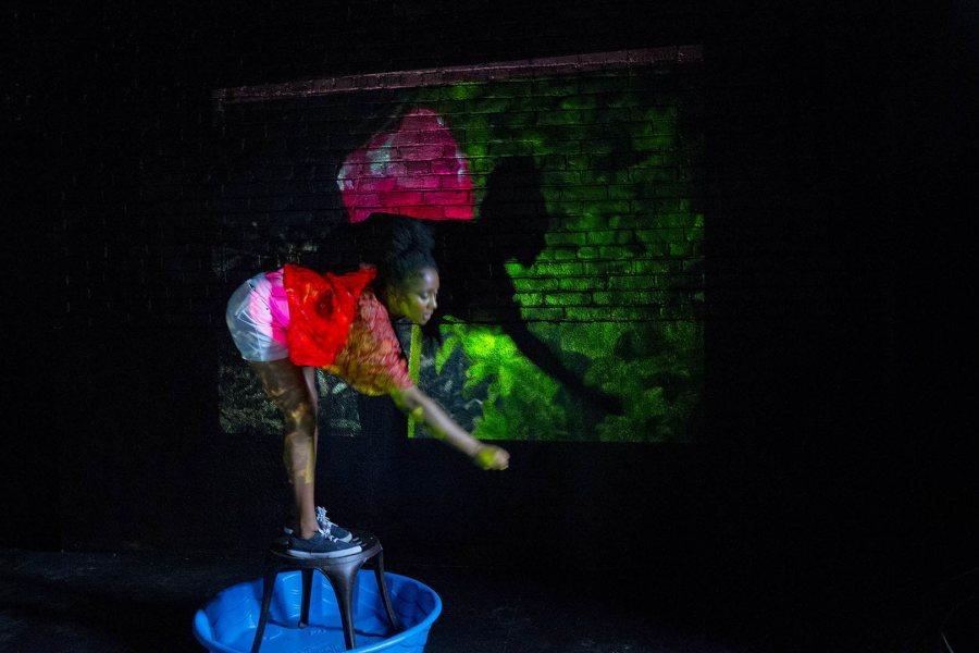Bates dancer Raissa Vodounon '17 performs in a piece by Tomisha Edwards '15. Phyllis Graber Jensen/Bates College.