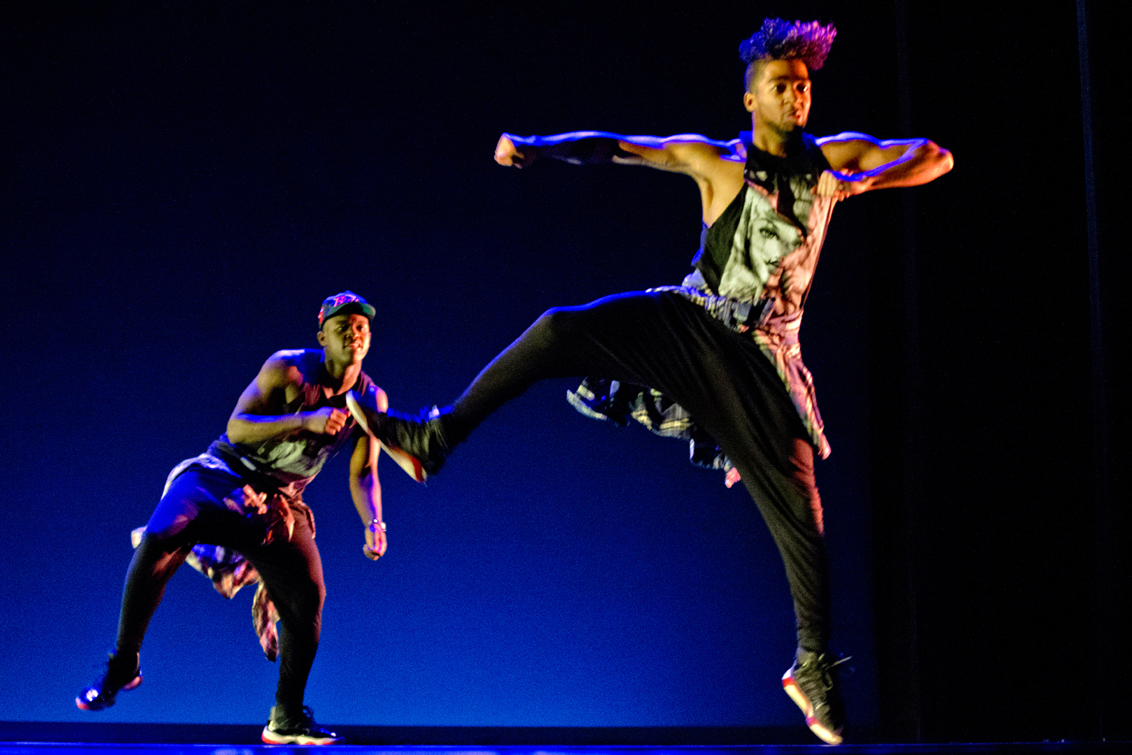 """Isaiah Rice '15 dances in his thesis work, Power Lines,"""" with Olivier Brillant '17 in the 2015 Spring Dance Concert. (Phyllis Graber Jensen/Bates College)"""