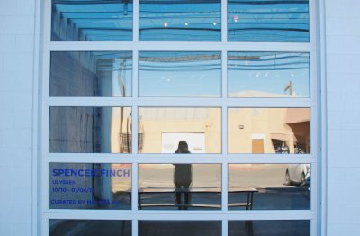 Martha Schnee '15 captures a self-portrait reflected in the facade of a Marfa art gallery.