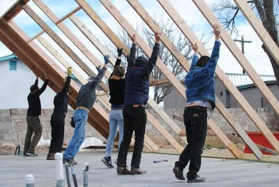 Carpenters put up a wall frame in Marfa, Texas. (Martha Schnee '15)
