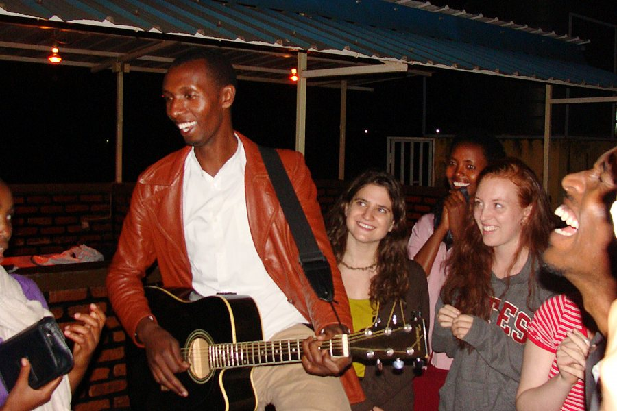 "Bates students and survivors gather for music and fellowship during the 2013 Short Term.  ""Interactions with survivors of genocide is not only about the past and grievance but also about sharing laughter within the present despite of it all.The attached picture features"