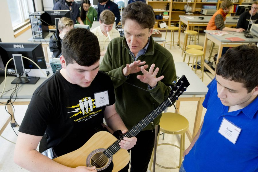 """During an on-campus Admitted Student Reception, Professor of Physics (and guitarist) John Smedley works with two prospective Class of 2019 students in the """"Musical Waves and Spectra"""" master class. (Phyllis Graber Jensen/Bates College)"""