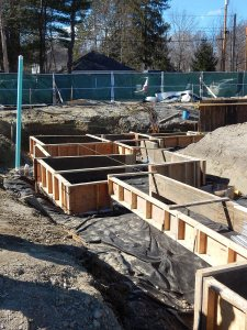 Wooden forms for wall (narrow) and spread (wide) footings at 55 Campus Ave. on April 14, 2015. (Doug Hubley/Bates College)