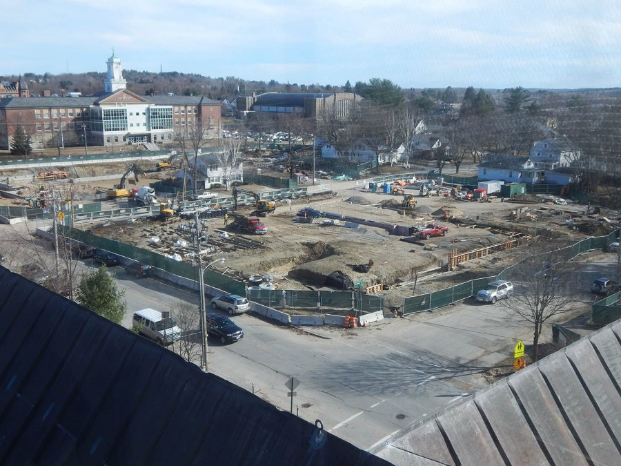 Somewhat distorted by reflections in the glass, this image of the Campus Avenue construction sites (65 Campus is to the left) was taken on April 14, 2015, from the Bates greenhouse atop Carnegie Science Hall. (Doug Hubley/Bates College)