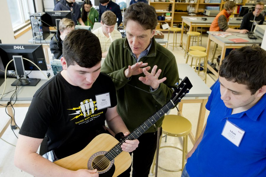 "Professor of Physics (and guitarist) John Smedley works with two Class of 2019 admitted students in the ""Musical Waves and Spectra"" master class, offered during the on-campus Admitted Students Reception on April 10, 2015. (Phyllis Graber Jensen)"