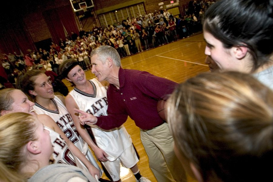 Jim Murphy congratulates his team after a win vs. Bowdoin on Feb. 1, 2005. The victory was Murphy's 200th career victory, en route to 343 career victories. (Phyllis Graber Jensen/Bates College)