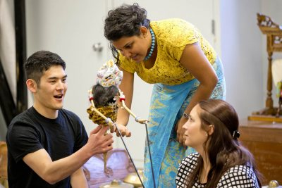 Sulochana Dissanayake '09 explains a fine point of puppet communications to students in the course Performing Musical Art of Indonesia, Taizaburo Inoue '18 of Toon-Shi, Japan, and Leah Zulkoski '15 of Charlotte, Vt. (Phyllis Graber Jensen/Bates College)