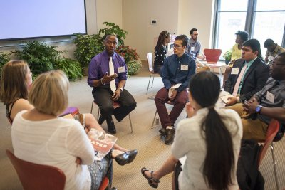 """Stephen Gresham '03 (speaking) was one of seven alumni to offer wisdom from their own working lives during the May 2015 """"Working Weekend"""" program. (Josh Kuckens/Bates College)"""